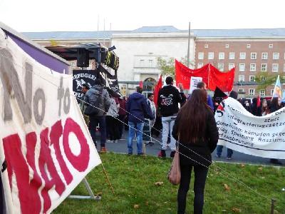 """Photo: Vor dem """"BAMF"""" Transparent mit der Aufschrift """"No to NATO"""""""